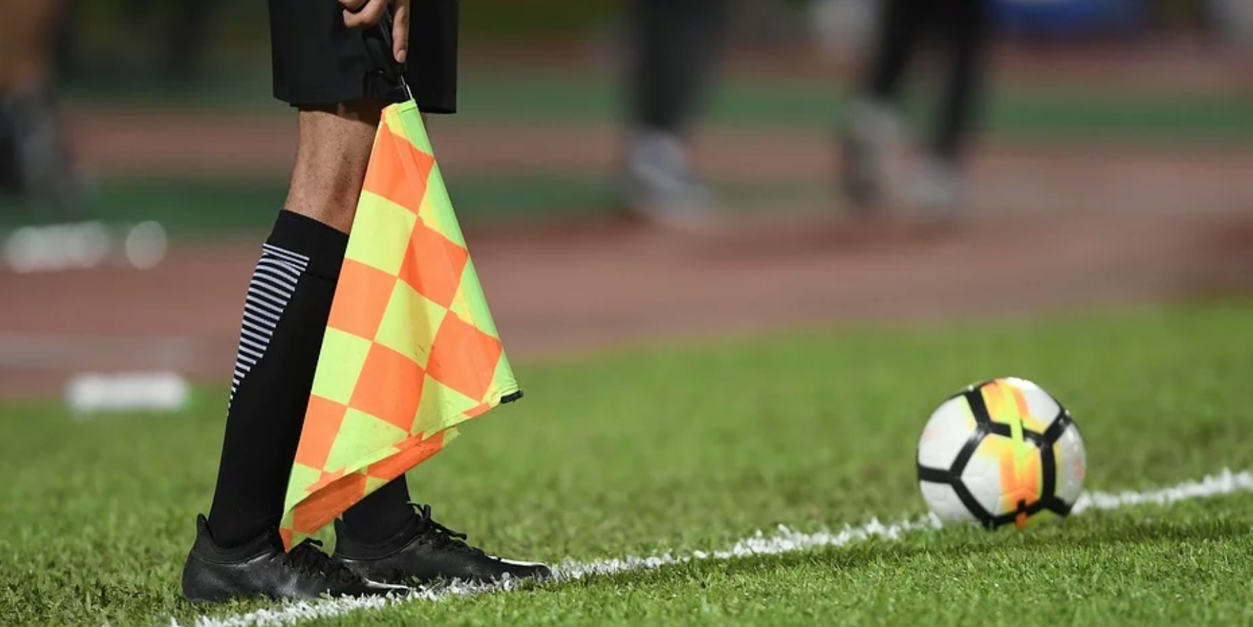 Referee Holding Offside Flag